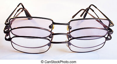 Spectacles b - Three pairs of spectacles together against a...