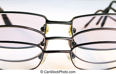Spectacles d - Three pairs of spectacles together against a...