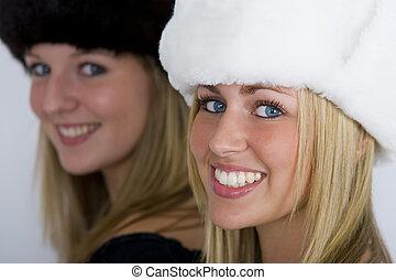 Beautiful Russians - Two beautiful Russian women wearing fur...
