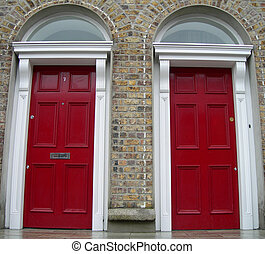 Twin red doors - Two Symmetrycal red doors in Dublin,...