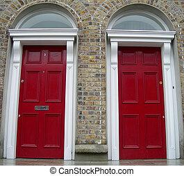 Twin red doors - Two Symmetrycal red doors in Dublin,...