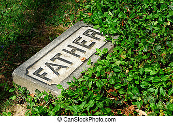 Here Lies My Father - A stone with the word father etched in...