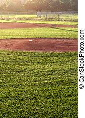 Field of Dreams - A baseball field cast in early morning...