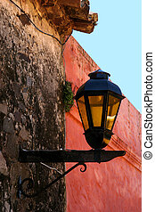 Lamp on the wall - Lamp on the old wall in Colonia, Uruguay