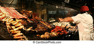 Cooking meat - Argentinian chef cooking meat in the...