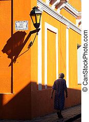 Colonia, Uruguay - Elderly lady walking on the street in...