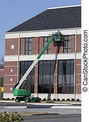 High lift workers series 7 - Workers doing repairs on siding...