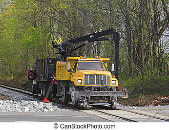 Railroad Repairs - Backhor mounted on railroad truck is...