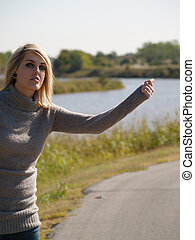 Blonde Hitch Hiker - Blonde girl hitching a ride
