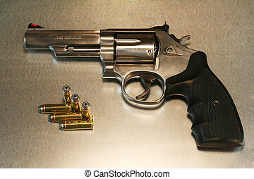 Revolver - 357 Magnum Revolver with Bullets on Metal...
