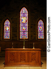 Church Alter in front of stained glass windows