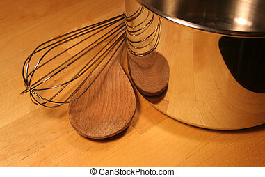 Cooking Tools sitting on a wooden table.