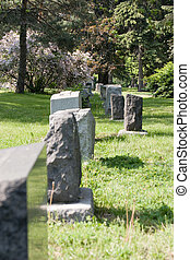 Cemetery - A row of tombstones in a cemetery