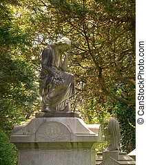Memorial grave markers at historic Spring Grove Cemetery in Cincinnati Ohio USA.  Spring Grove is the second largest cemetery in the United States and was established in 1845.