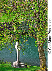 Memorial cross on the riverbank at historic Spring Grove...