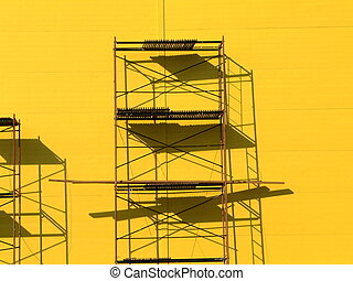 Scaffolding - Constructions scaffolding on the yellow wall...