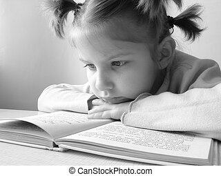 girl with book - black and white portrait of the small...