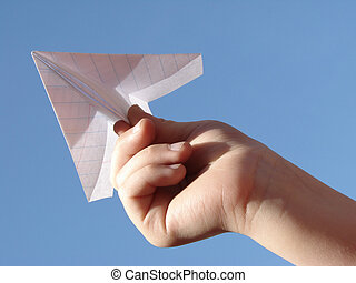 hand with plane 1 - childs hand with paper plane