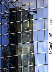 Reflections of office skyscraper
