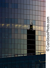 Corporate office building facade and reflection of other...