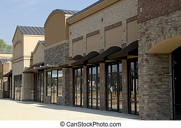 Storefronts on a new shopping plaza ready for occupancy