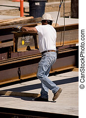 Ironworker - A construction worker handling an iron beam