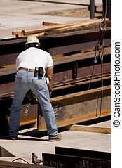 Ironworker - A construction worker handling an iron beam