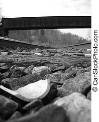 On The Tracks - Picture Close Up inside train tracks. Black...