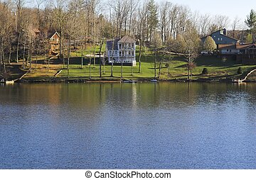 Beautiful lake homes in the mountains, spring time has...