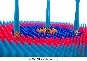 Target Practice - Isolated photo of red and blue toy darts...