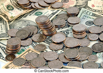 Pile of money - Coins and cash in a pile
