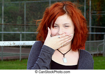 Don't Make Me Laugh - Laughing teenage girl covering her...