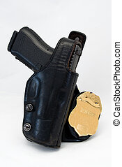 Badge and Gun - A police officer badge and gun in holster,...