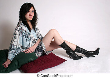 Chinese woman legs - A chinese woman sitting on pillows with...