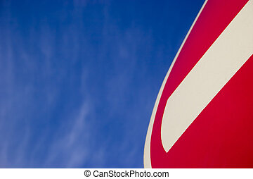 No Entry sign - Fragment of No Entry sign on blue sky