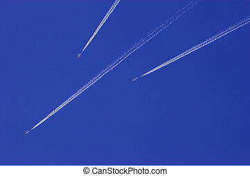 Jet airplane in blue sky - Three Jet airplanes in blue sky....