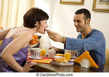 breakfast - healthy living: young couple having breakfast at...
