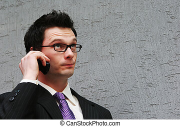 Man with a puzzled face - Smart businessman makes a phone...
