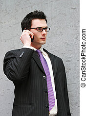 On the phone to a client - Smart businessman makes a phone...