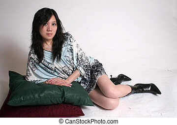 Reclining woman - A chinese woman reclining on pillows