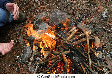 Small Camp Fire - Small camp Fire lighting in the rain,...