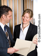looking at files - two business people looking at some files