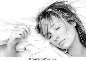 Woman Sleeping - High key black and white image of pretty...