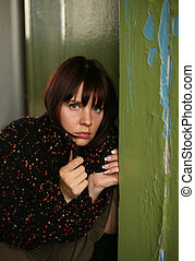 Cautious - The beautiful sad brunette was rested against an...