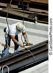 Ironworker - A construction worker hooking up iron beams