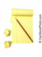 Brainstorming ideas - A notepad and crushed paper for an...
