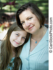 Mother & Daughter Portrait - Portrait of a pretty mother and...