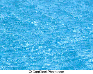 Light blue water surface in swimming pool