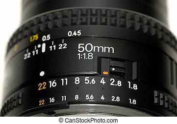SLR Lens - Close up shot of a 50 mm slr lens