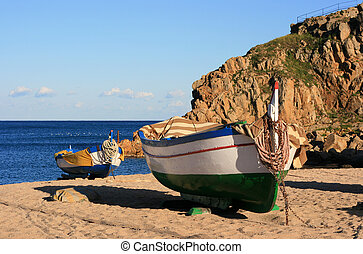 Old fishing boats on the beach